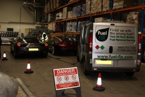 Fuel Fix van at work alongside danger sign
